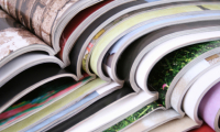stack of open magazines, close-up